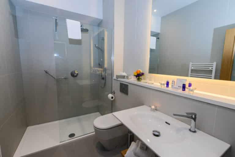 Merrion Suite at PREMIER SUITES PLUS Dublin Ballsbridge en-suite bathroom with walkin shower