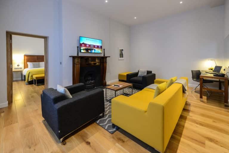 Merrion Suite at PREMIER SUITES PLUS Dublin Ballsbridge looking from lounge to bedroom