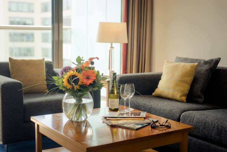 PREMIER SUITES Dublin Sandyford lounge with flowers and wine