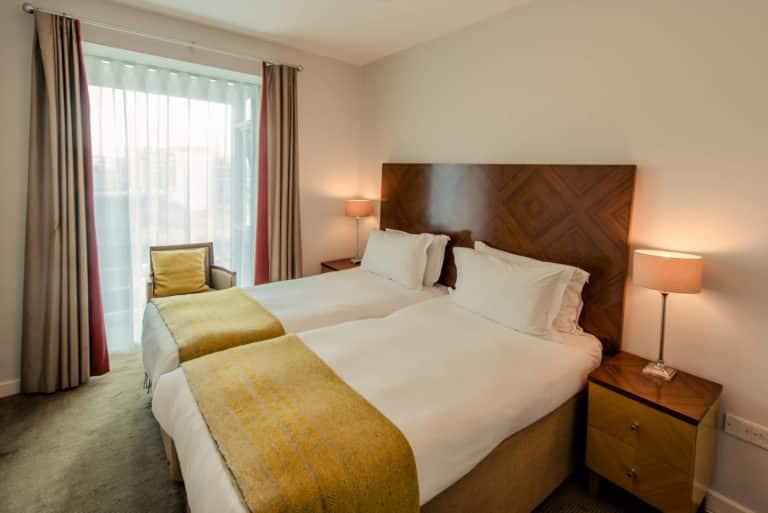 PREMIER SUITES Dublin Sandyford spacious bedroom