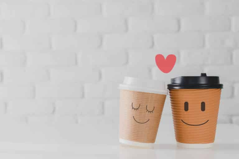Two,Coffee,Cup,With,Smiling,Face,Of,Man,And,Woman